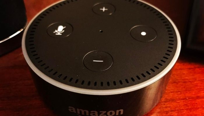Amazon Echo Dot on wood surface