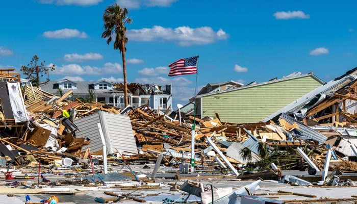 Buildings destroyed by hurricane and U.S. Flag still standing